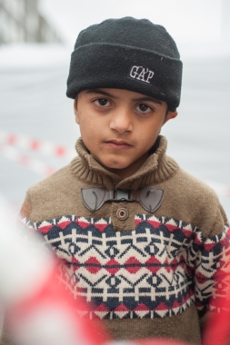 Heja Rashidali, 9, waits at a temporary holding station for newly arrived migrants at Munich Central Station. He and his family traveled over 2000 miles and made several dangerous border crossings to reach Germany. They do not know where they will end up with migrants being transported to various cities in Germany or potentially other countries in the E.U.