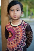 Zhara Ashori, 4 years old, from Ghazni, Afghanistan. She currently resides in temporary housing with her mother and two older sisters for migrants in Munich, Germany.The family worries about their future with no permanent home or formal schooling.