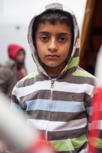 10 year-old Aziz Abdulhamad from Syria waits for a bus to temporary shelter for migrants at Munich Central Station. He is one of the many young children whos families have fled violence and unrest in their home countries and risked they lives on the trek to Germany to seek asylum.